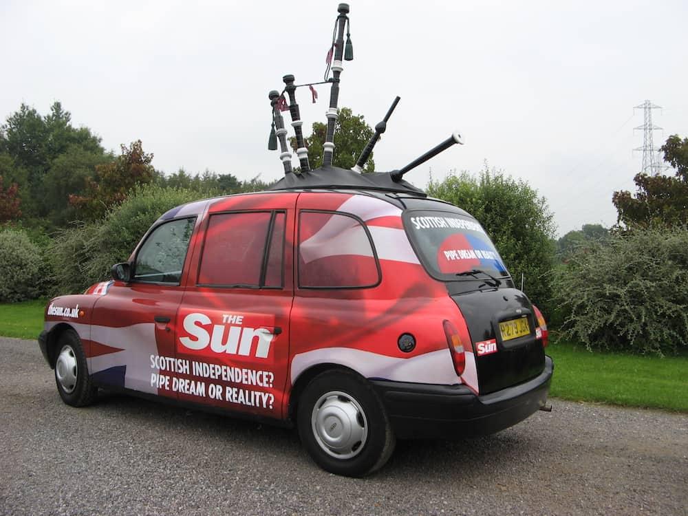 The Sun bagpipe taxi